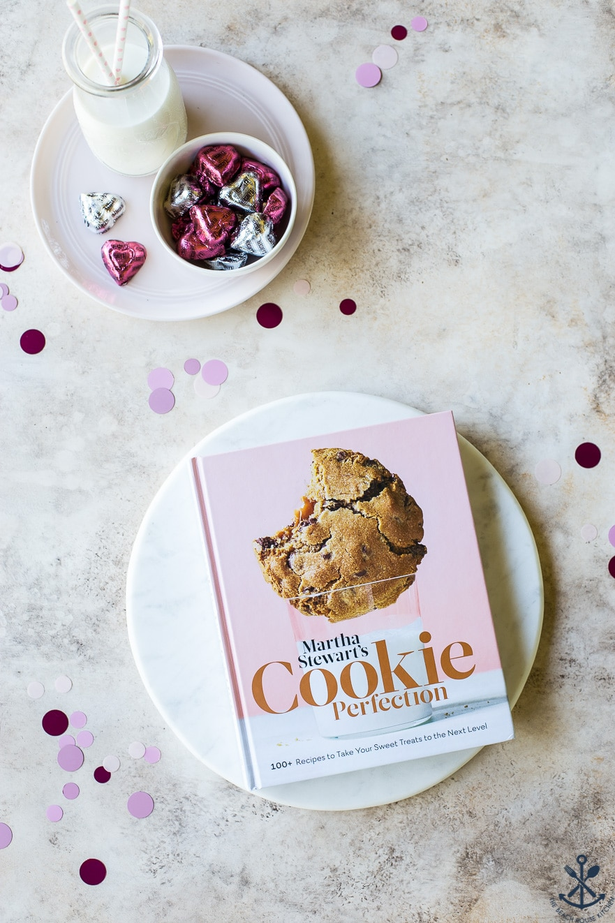 Overhead photo of Martha Stewart's Cookie Perfection cookbook on a round marble board