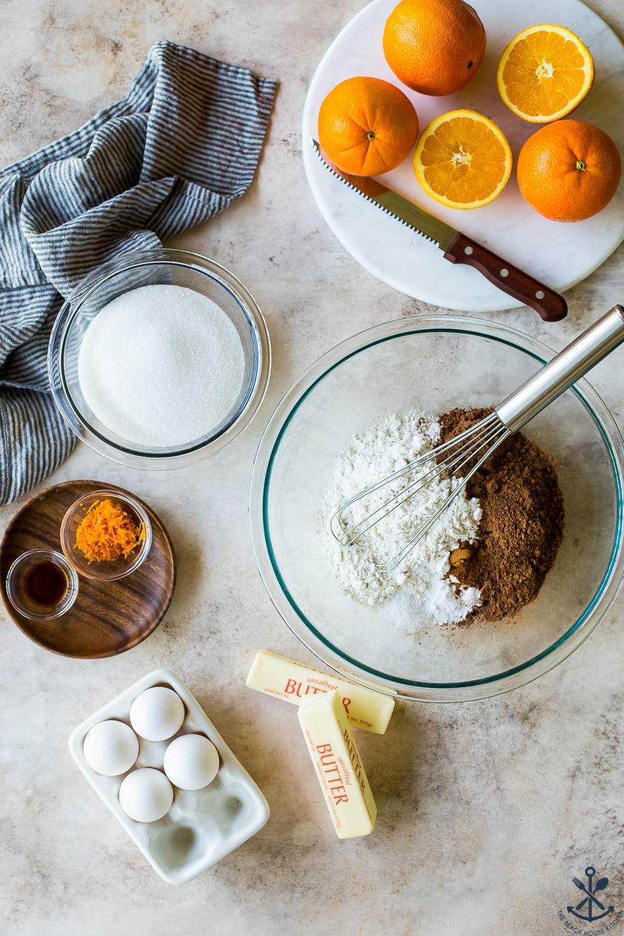 Overhead photo of the ingredients for a chocolate orange bundt cake in bowls.