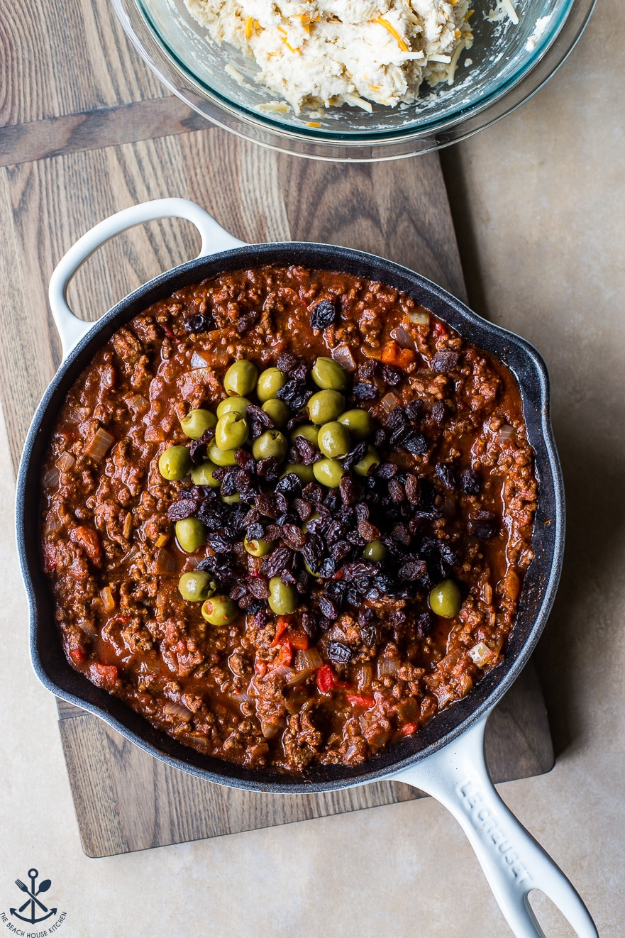 Overhead photo of skillet filled with Cuban beef picadillo
