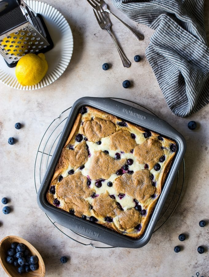 Overhead photo of lemon blueberry blondie cheesecake bars in 9x9 pan