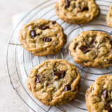 Almond Joy Chocolate Chip Cookies on a round wire cooling rack