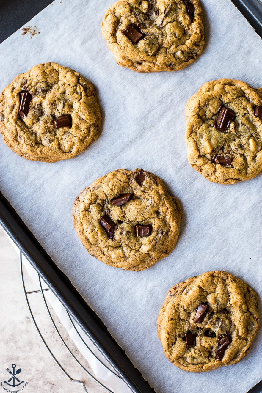 Overhead photo of almond joy chocolate chip cookies on a baking sheet lined with parchment