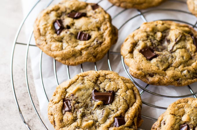 Six Almond Joy Chocolate Chip Cookies on a round wire cooling rack
