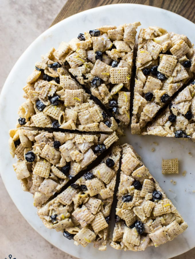 Overhead photo of wedges of blueberry Chex krispie treat on a round cake plate