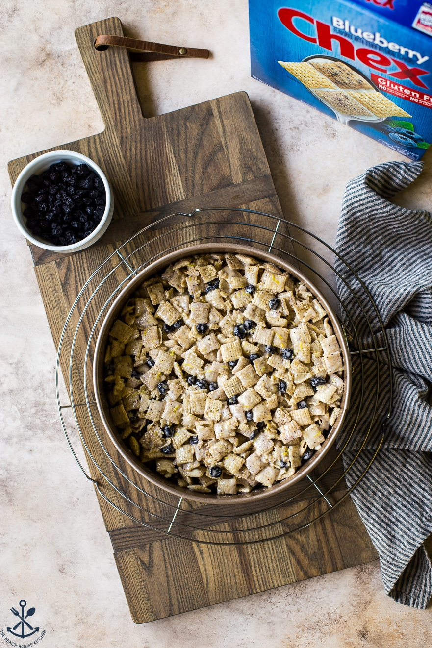 Overhead photo of blueberry Chex krispie treats in a springform pan on a wooden board