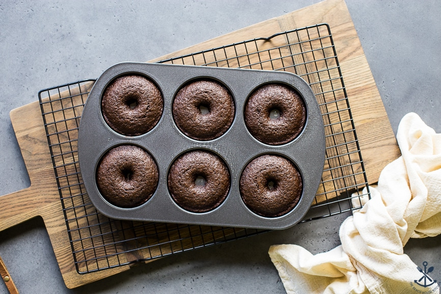 Overhead photo of baked cocoa coffee baked donuts in donut pan