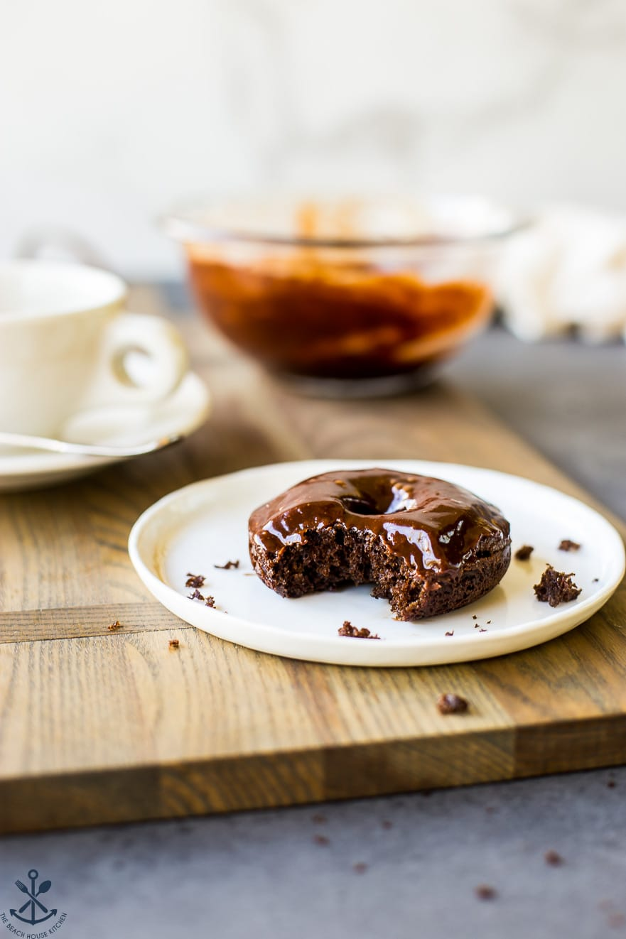 One cocoa coffee baked donut on a white plate
