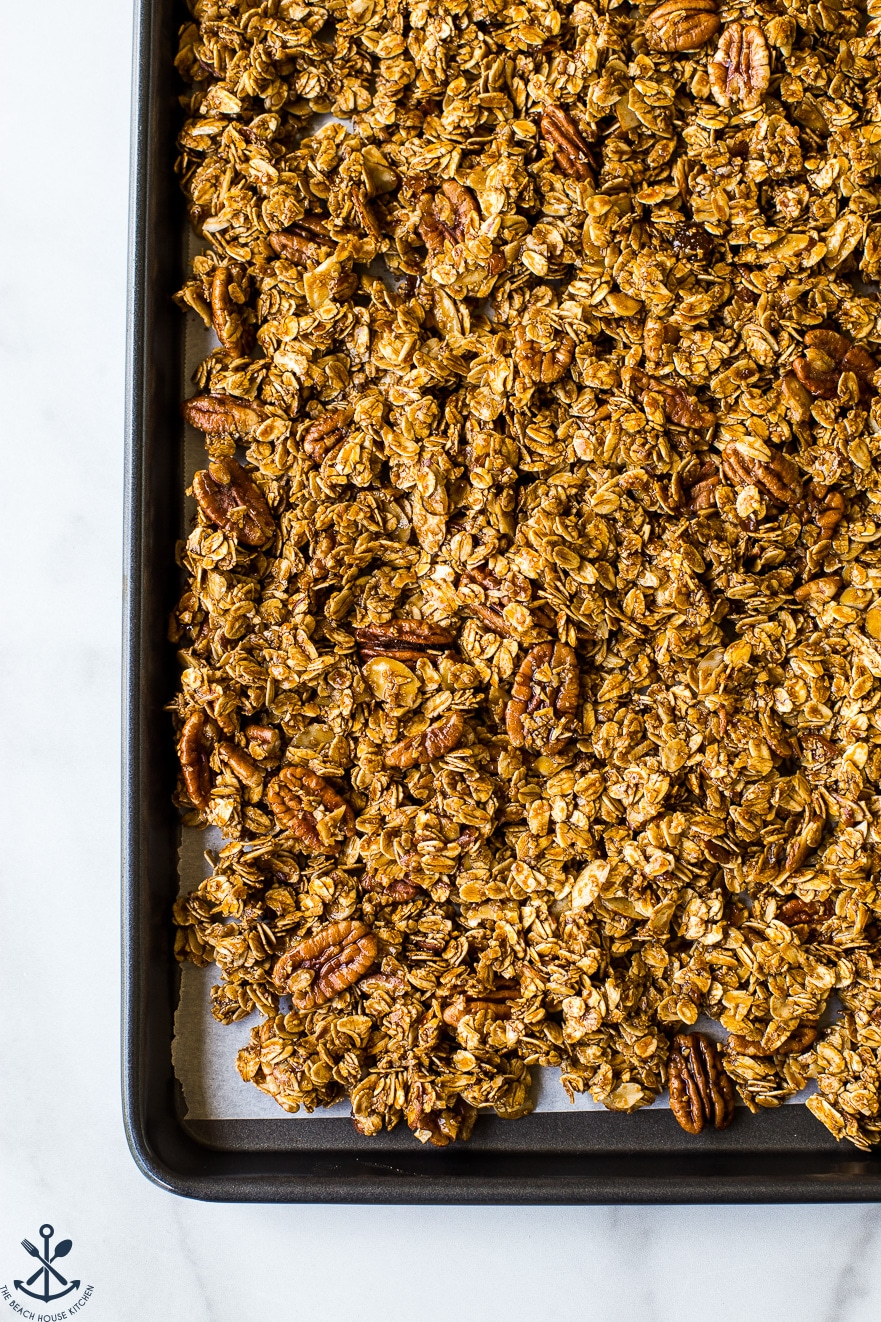 Overhead photo of cookie sheet filled with maple cinnamon granola