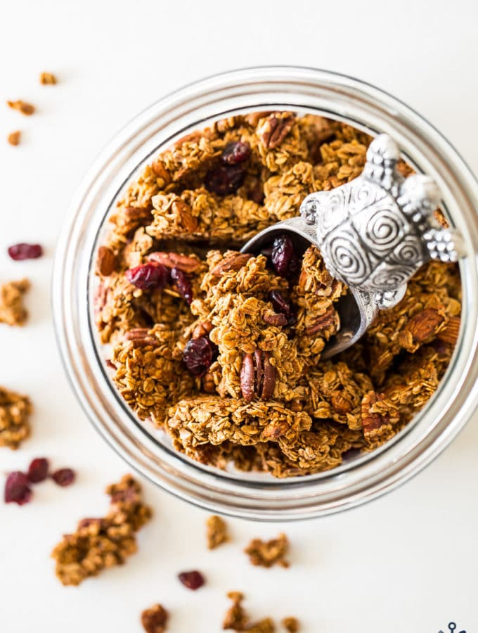 Overhead photo of glass jar filled with maple cinnamon granola