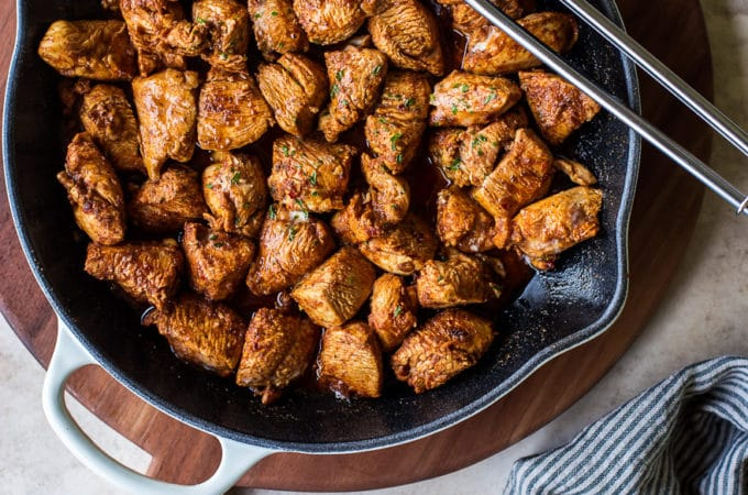 Overhead photo of skillet filled with Mexican spiced chicken bites