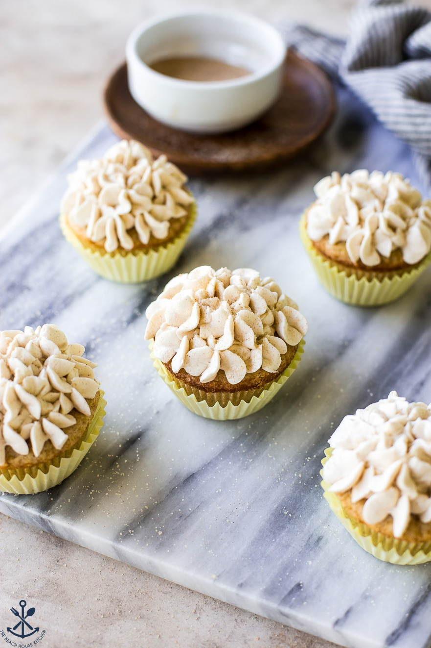 Snickerdoodle Cupcakes with Cinnamon Buttercream on a marble board