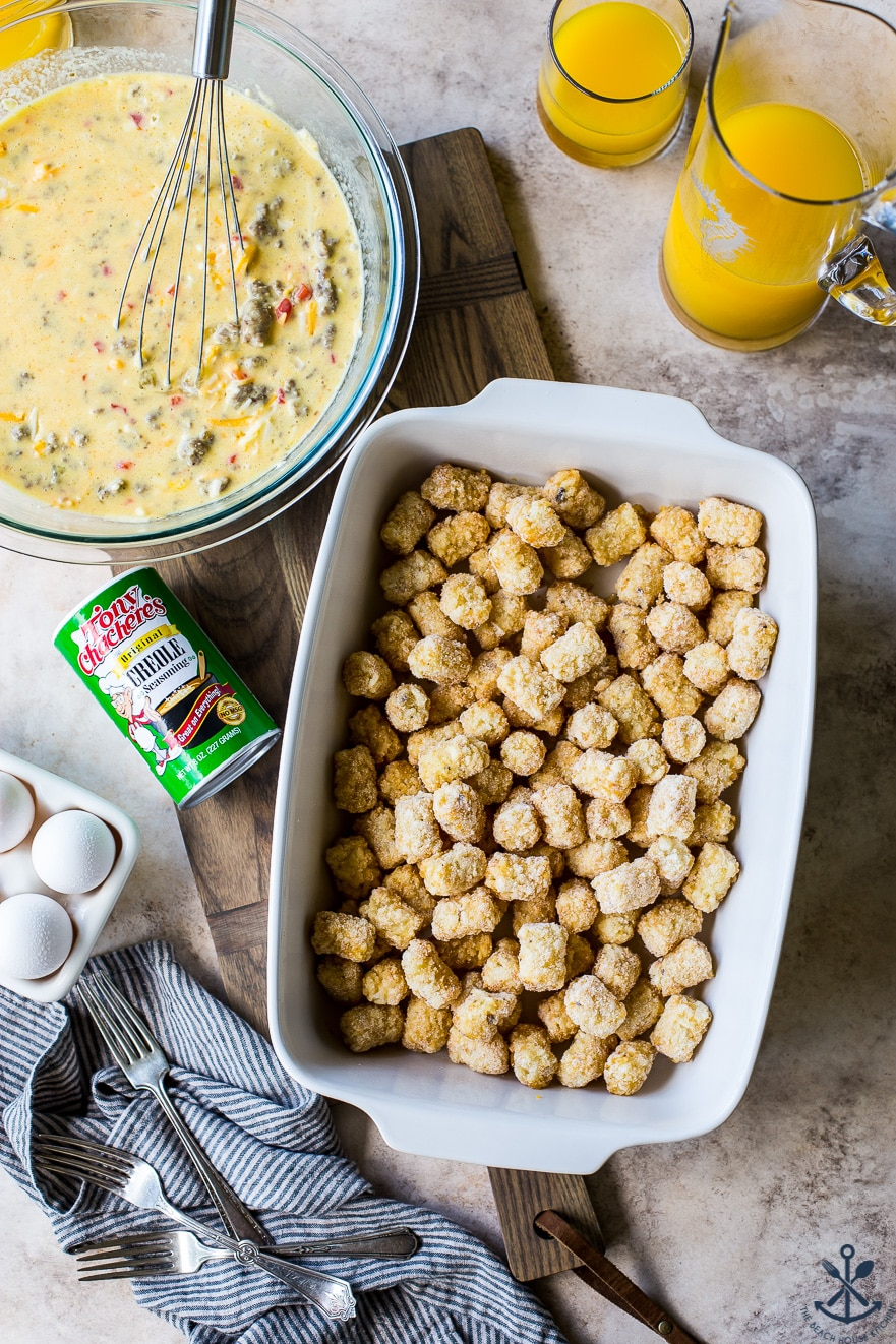 Overhead photo of white baking dish filled with tater tots