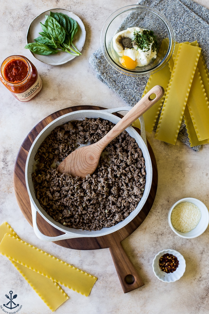 Overhead photo of ingredients for easy skillet stovetop lasagna and skillet filled with cooked ground beef