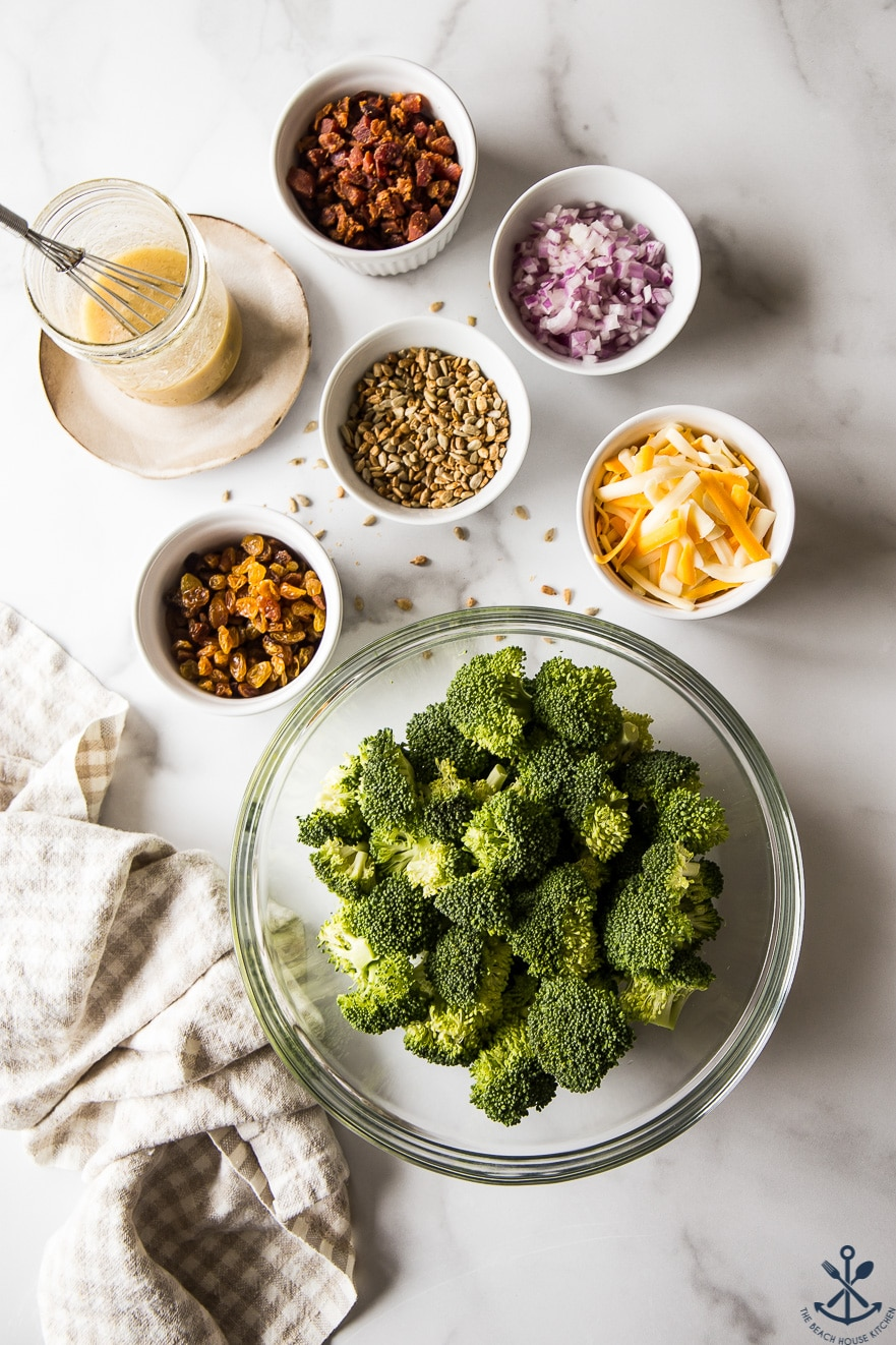 Overhead photo of ingredients for classic broccoli salad with bacon in bowls