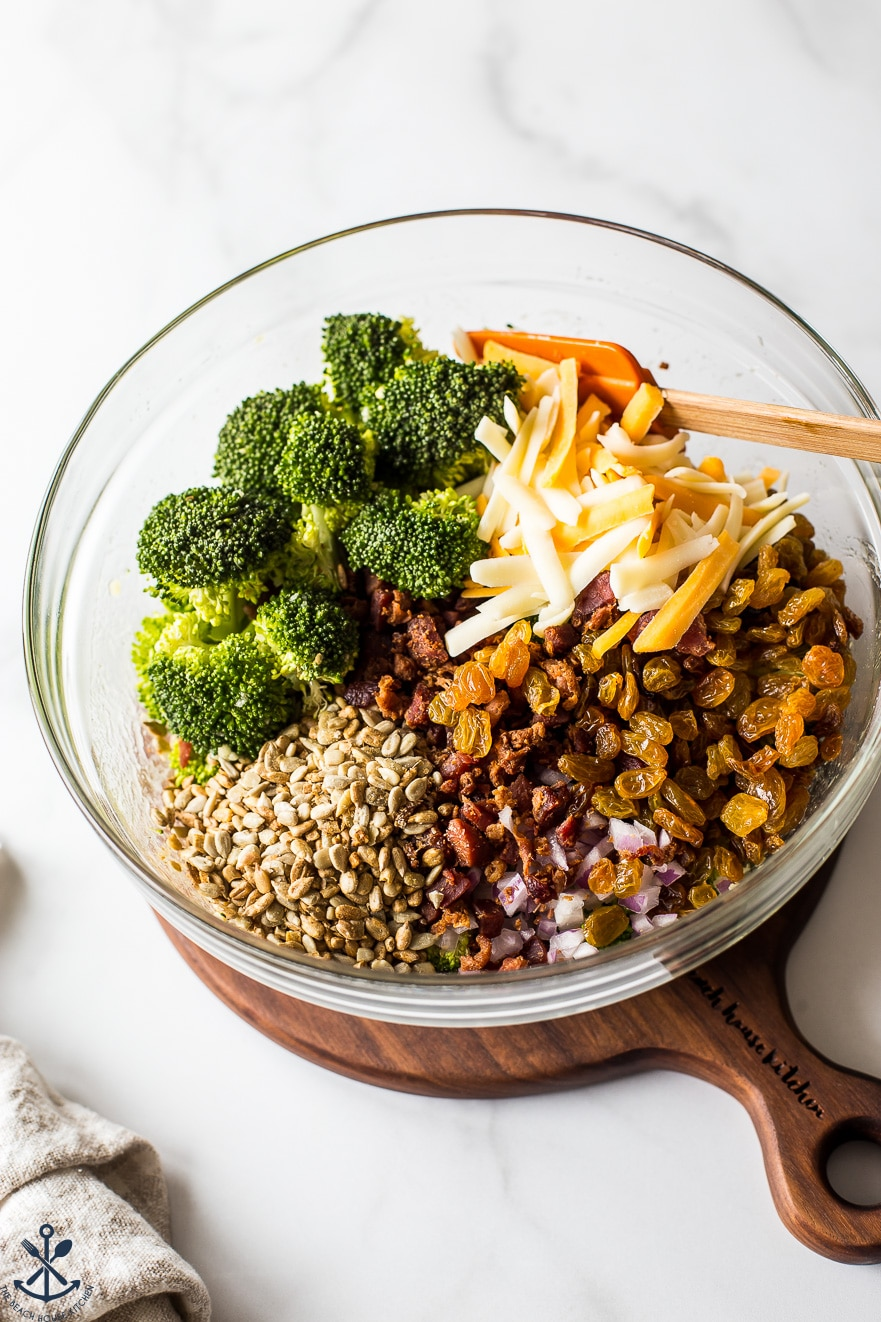 Ingredients for classic broccoli salad with bacon in a glass bowl