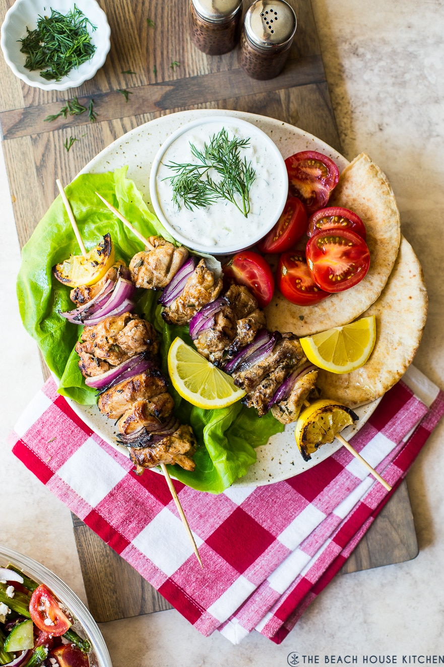 Overhead photo of Chicken Souvlaki Skewers with Tzatziki Sauce on a plate