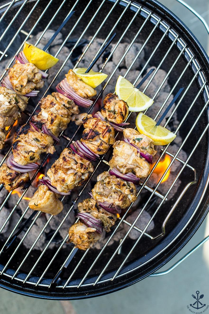 Chicken Souvlaki Skewers on a grill