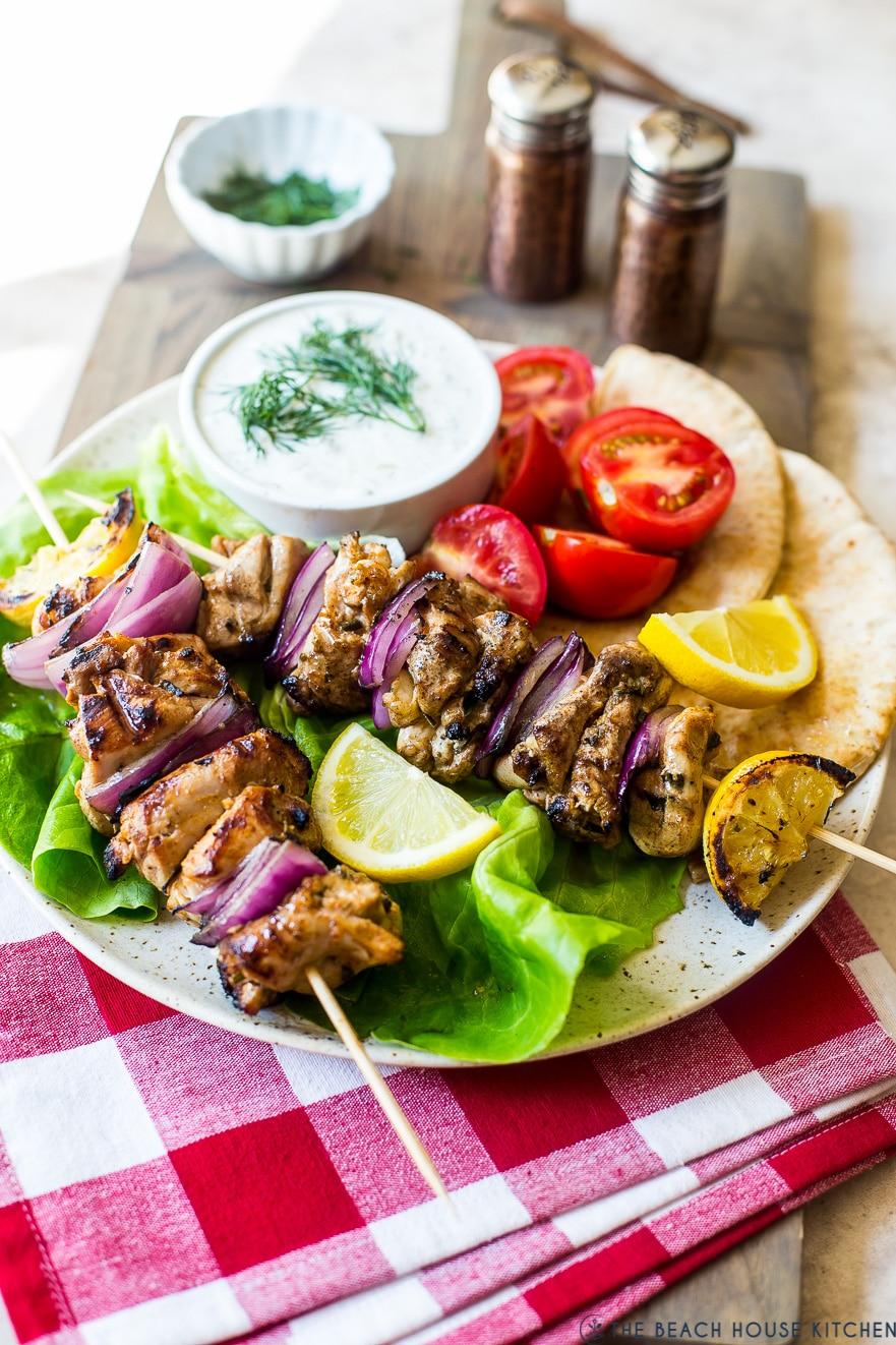 Chicken Souvlaki Skewers with Tzatziki Sauce on a plate