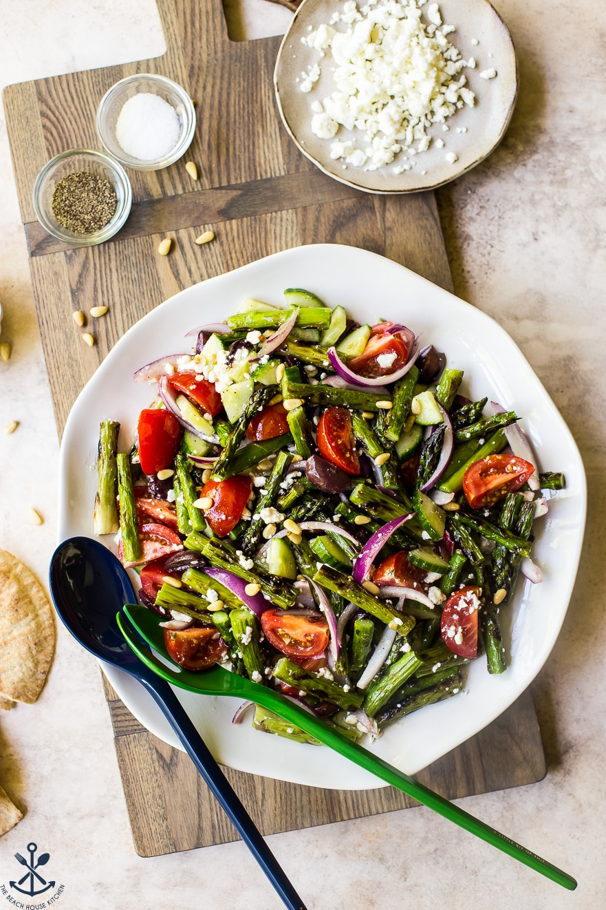 Overhead photo of grilled asparagus salad on a round white plate