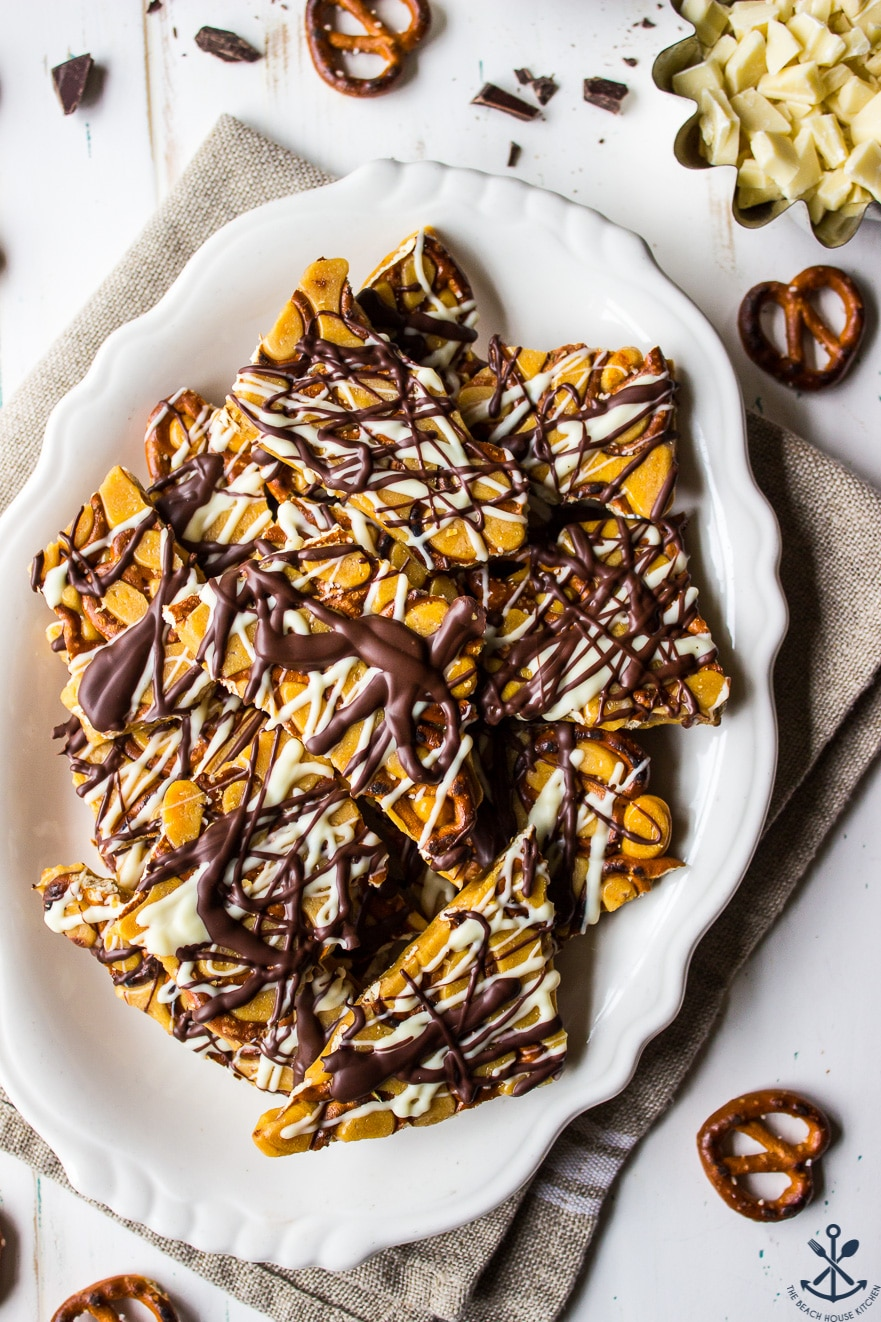 Overhead photo of pretzel toffee on white oval plate