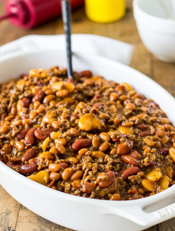 Baked Three Bean Casserole in a white oval dish