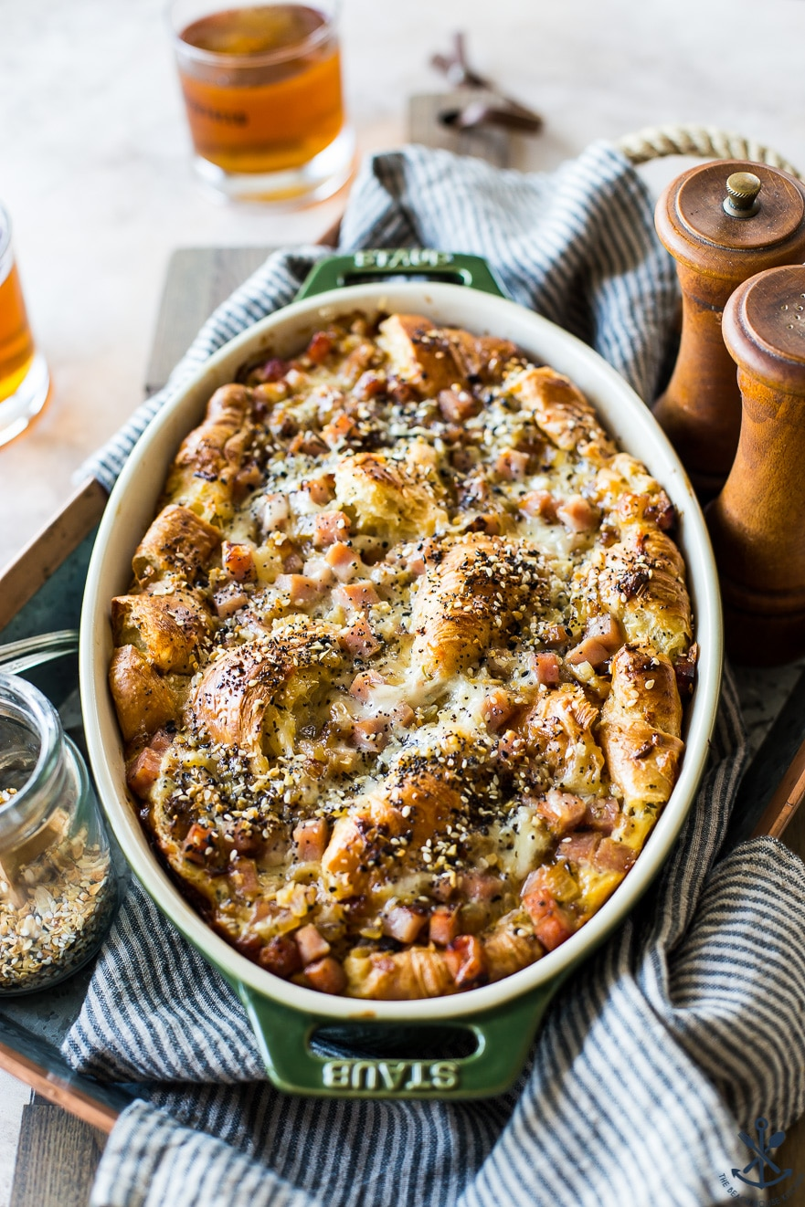 Croissant Bread Pudding with Ham, Swiss and Caramelized Onions in a baking dish