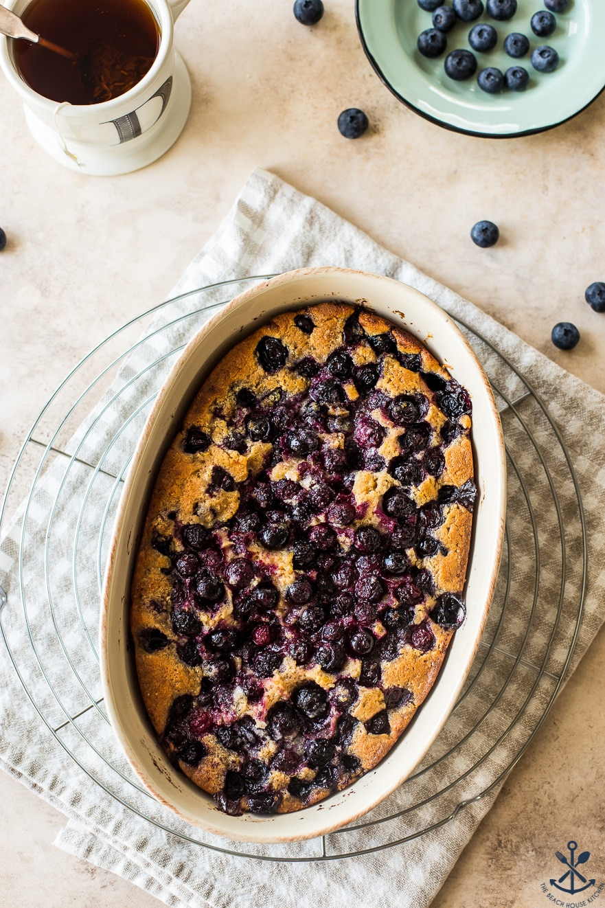 Overhead photo of Earl Grey Blueberry Cobbler in an oval baking dish