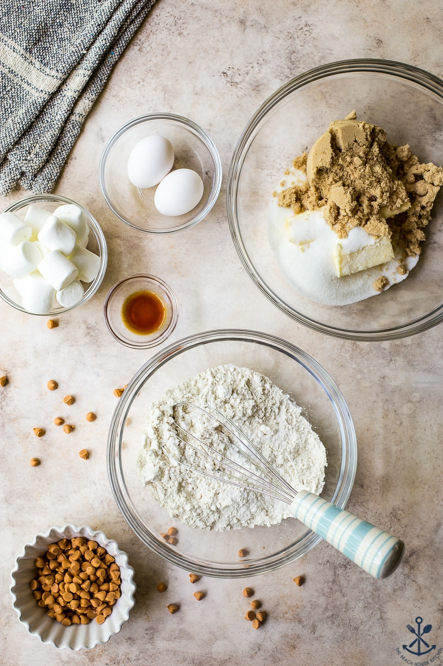 Overhead photo of ingredients for marshmallow butterscotch blondies in glass bowls