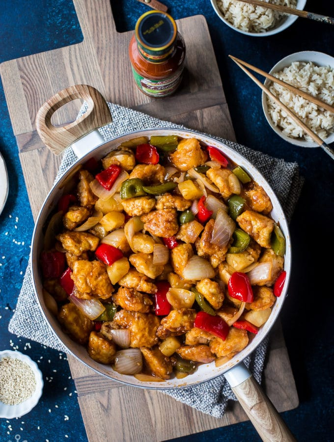Overhead photo of Sweet and Sour Chicken in a white skillet