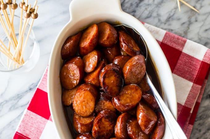 Overhead photo of oval white dish filled with maple bourbon bbq kielbasa bites