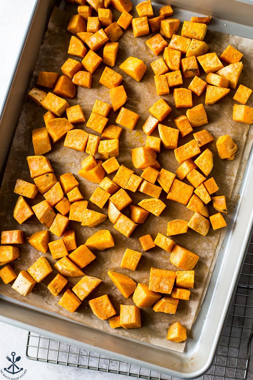 Overhead photo of sweet potatoes on a baking sheet