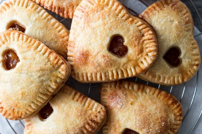 Overhead photo of peach hand pies on a round wire rack