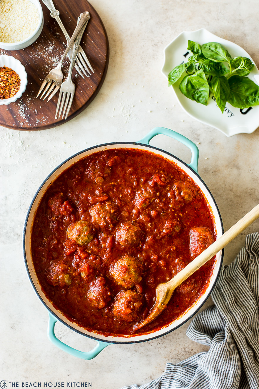 Overhead photo of skillet filled with Mom's meatballs and marinara sauce