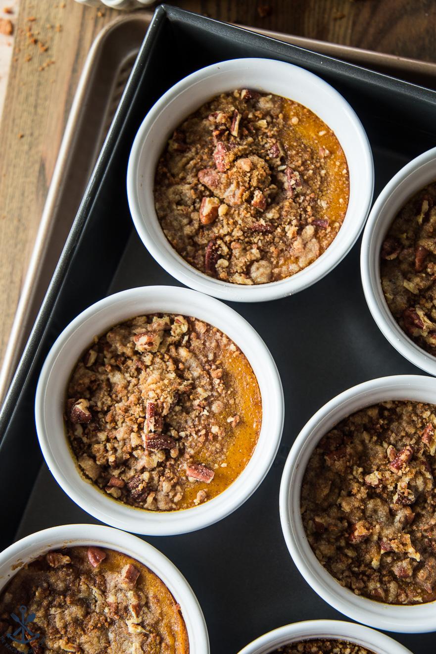 Pumpkin Custards with Gingersnap Crumble in white ramekins in roasting pan