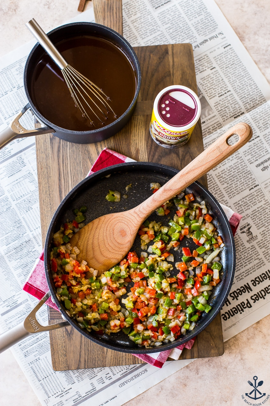 Overhead photo of green and red pepper and onion in a skillet