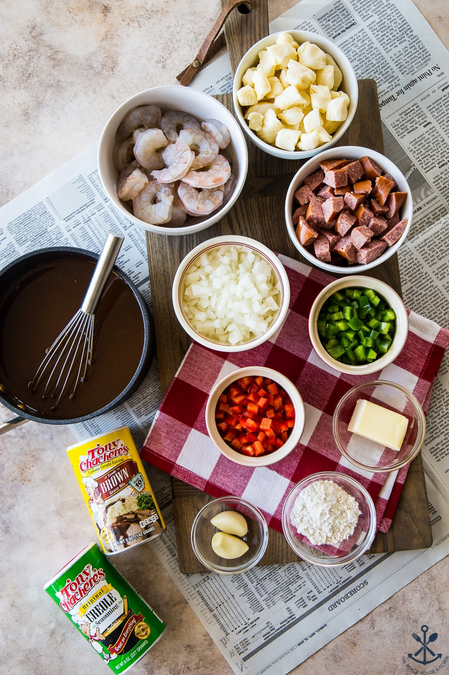 Overhead photo of ingredients for Cajun poutine is bowls