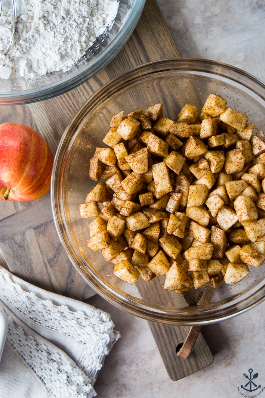 Overhead photo of glass bowl filled with cinnamon sugar-coated apple chunks