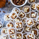 Overhead photo of Pumpkin Spice White Chocolate Pecan Caramels in white paper cups