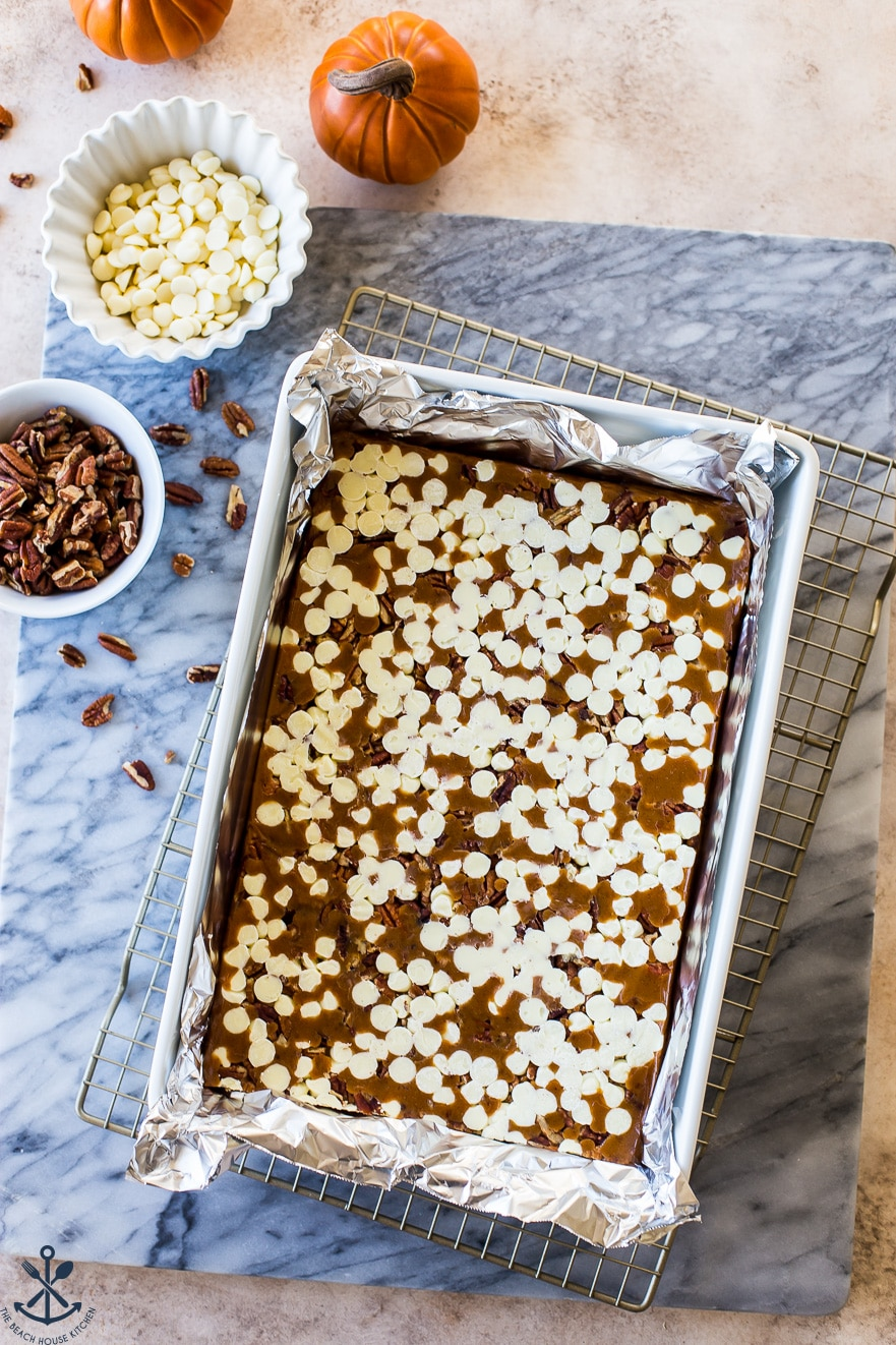 Caramels in a 9x13 pan on a white marable board