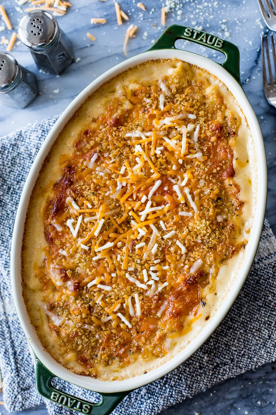 Close up overhead photo of macaroni and cheese in an oval dish on a marble board