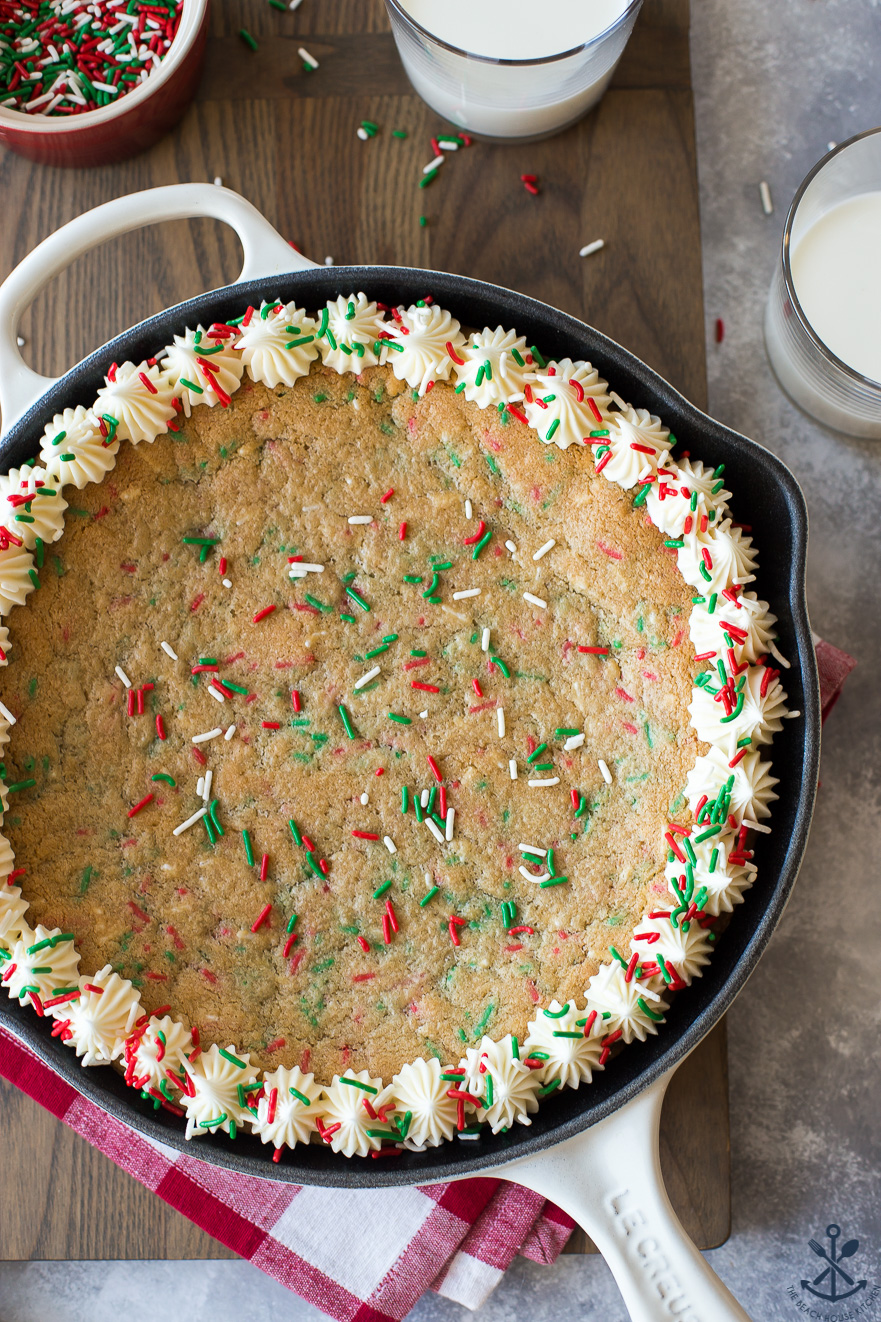 Overhead photo of Easy Holiday Funfetti Sugar Cookie Skillet on a wooden board