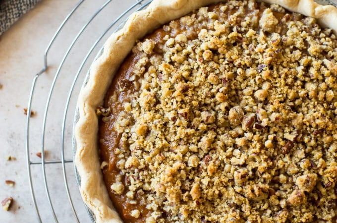 Overhead photo of Sweet Potato Pie with Pecan Topping on a round wire rack