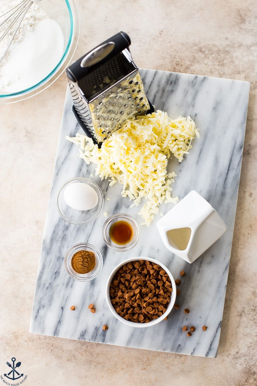 Overhead photo of ingredients for cinnamon chip scones on a marble board