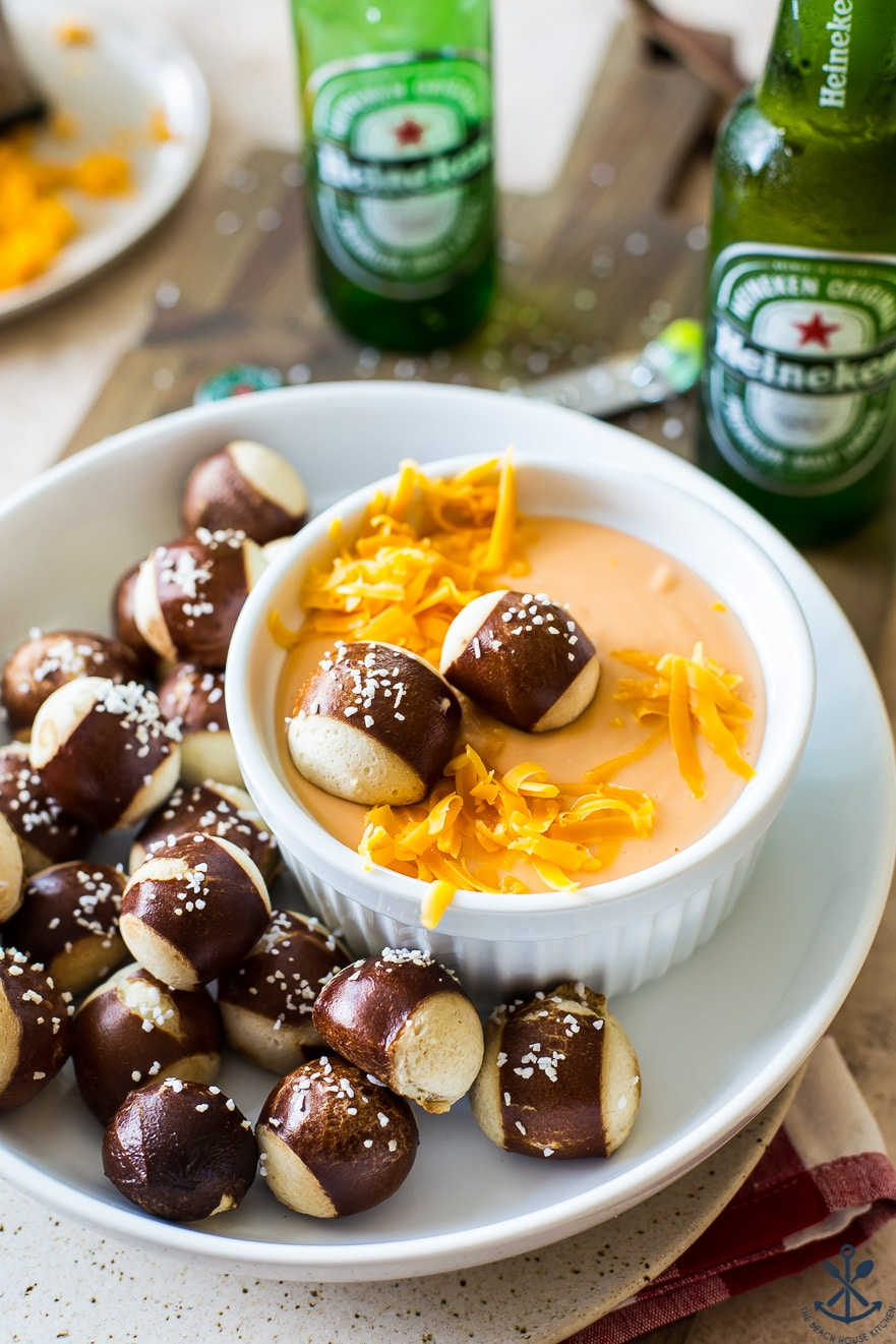 Cheese dip in a bowl with pretzel nuggets