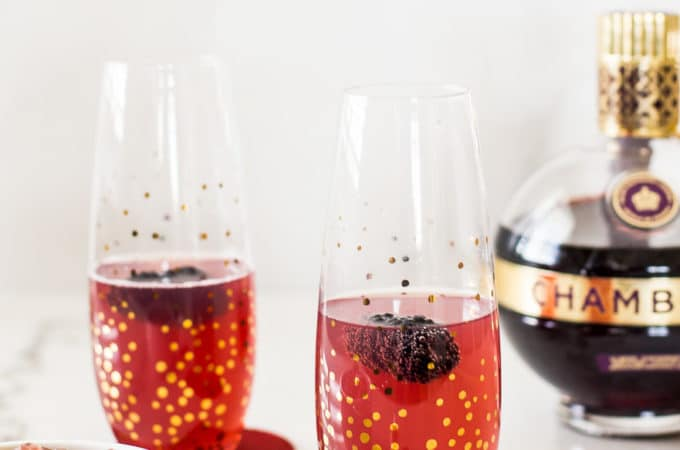 Up close photo of Chambord Fizz and Gummies with a bottle of Chambord in the background