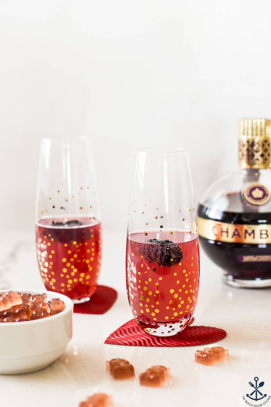 Up close photo of Chambord Fizz and Gummies with a Chambord bottle in the background