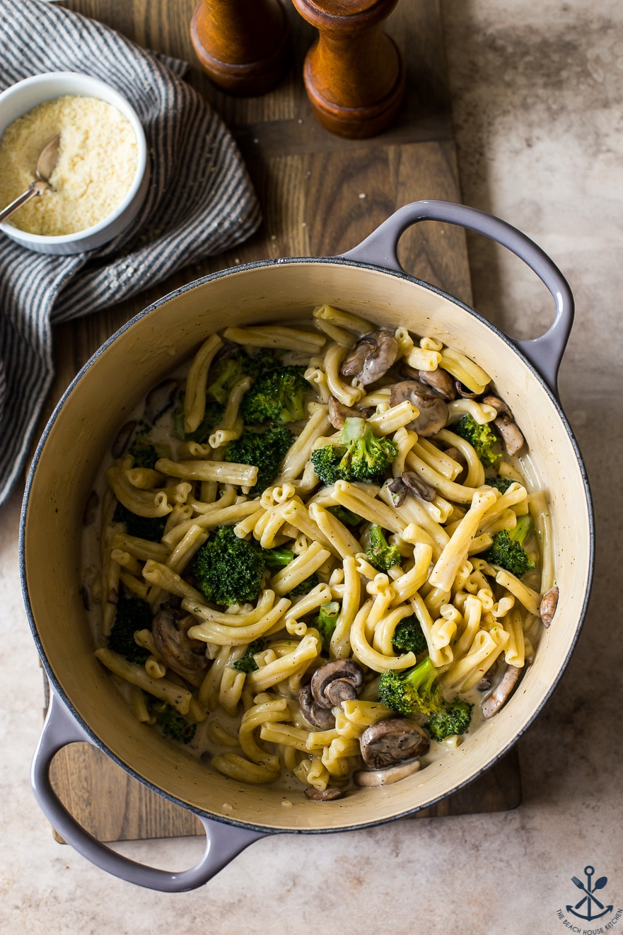 Overhead up close photo of pot filled with pasta with mushroom and broccoli