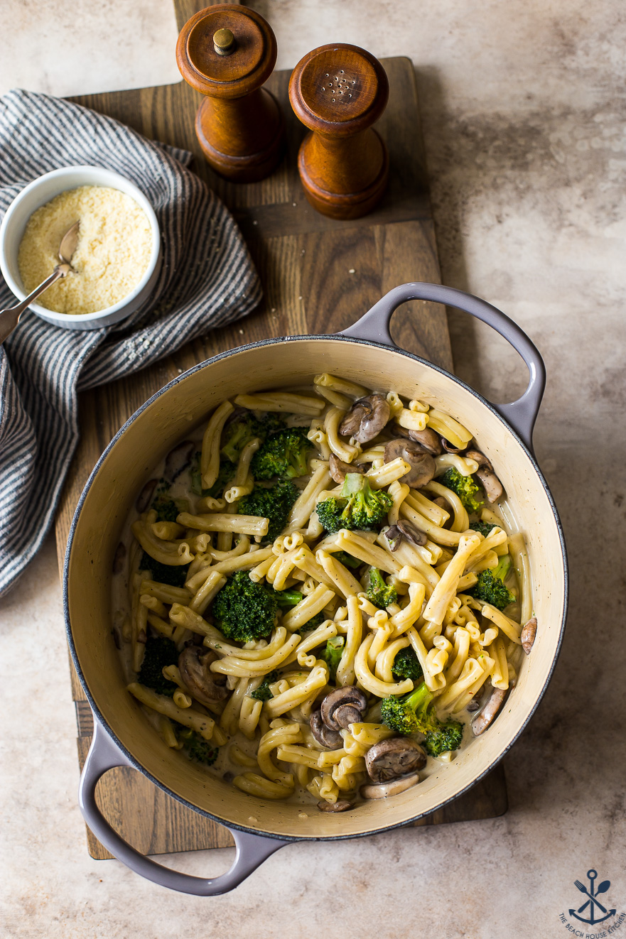 Overhead photo of pot filled with Creamy Garlic Broccoli Mushroom Pasta