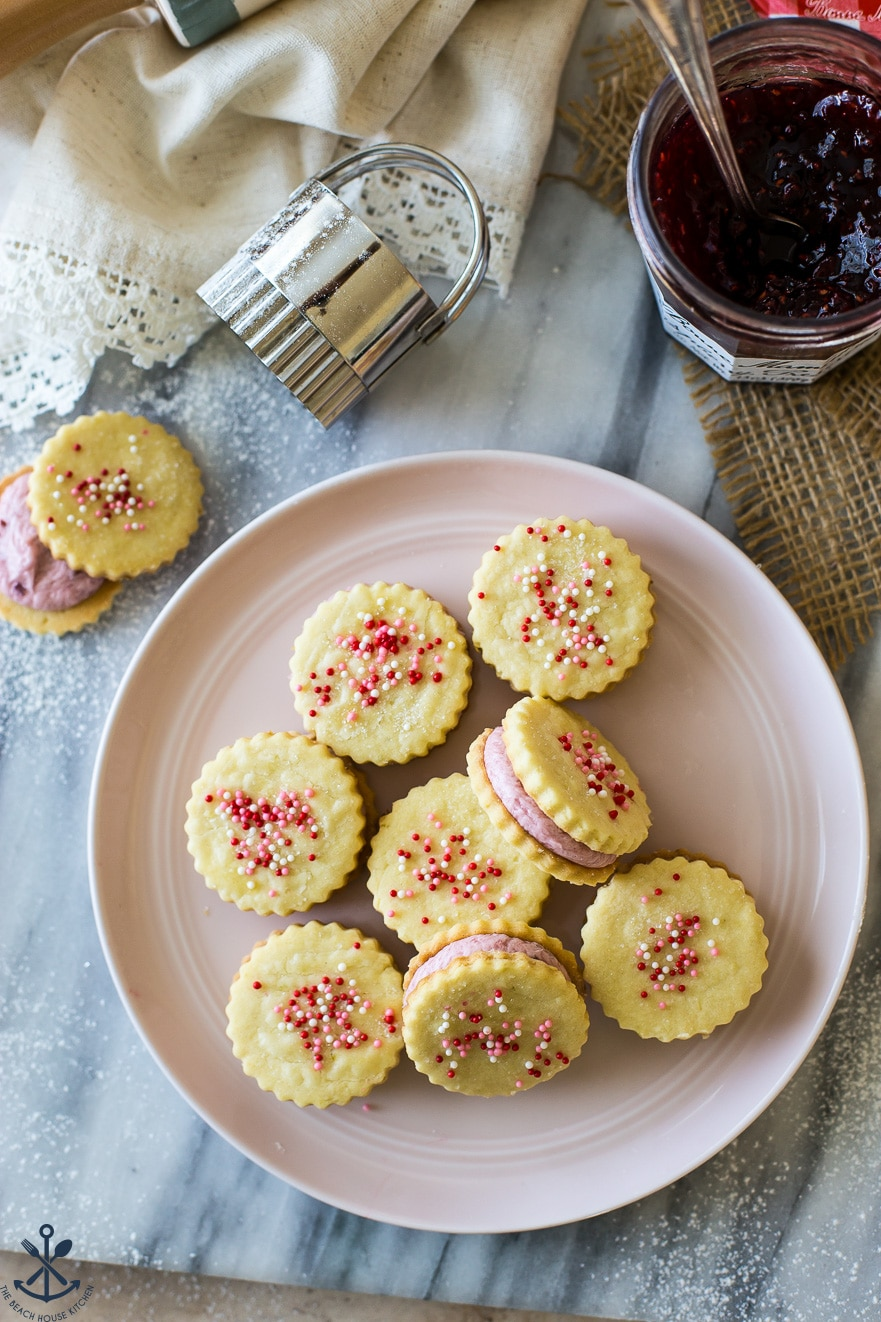 Up close overhead photo of Key Lime Sandwich Cookies with Raspberry Buttercream