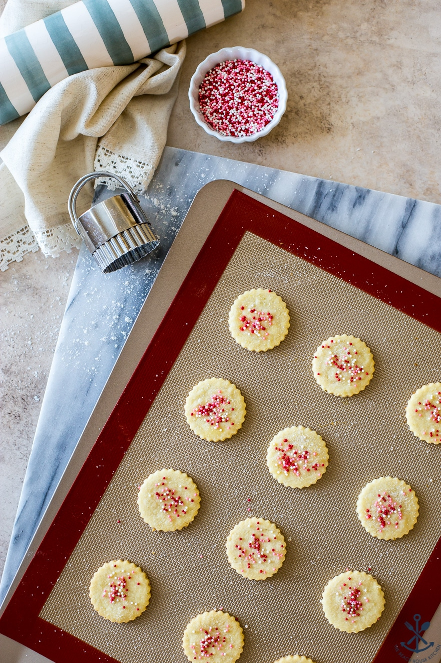 Overehad photo of tray of round butter cookies with nonpariels